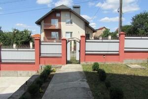 Продается дом на 3 этажа 335.5 кв. м с участком