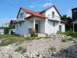 Продается дом на 2 этажа 245 кв. м с гаражом