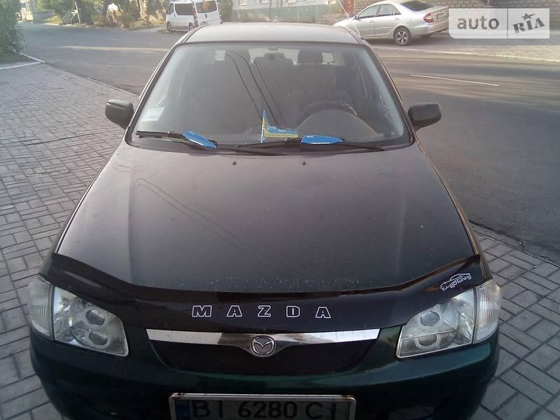 Mazda 323 1999 года