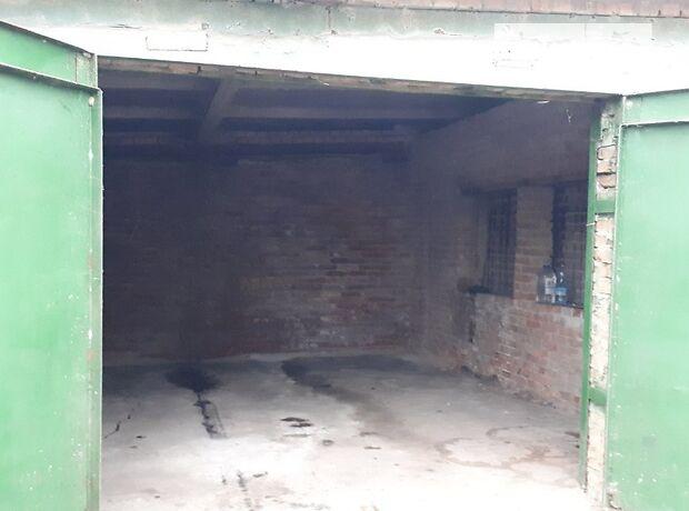 Место в гаражном кооперативе под легковое авто в Лубнах, площадь 22 кв.м. фото 1