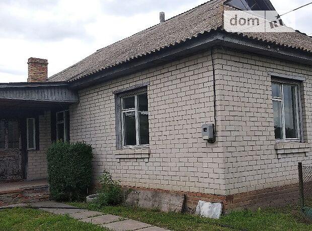 одноэтажный дом с гаражом, 110 кв. м, кирпич. Продажа в Русской Поляне (Черкасская обл.) фото 1