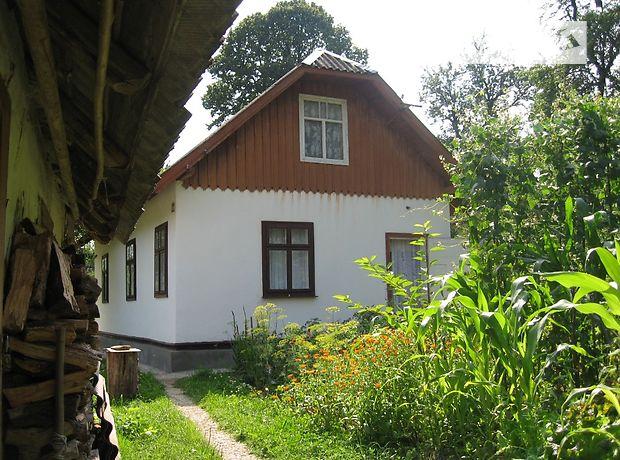 одноэтажный дом с садом, 52 кв. м, дерево и кирпич. Продажа в Новом Кропивнике (Львовская обл.) фото 1