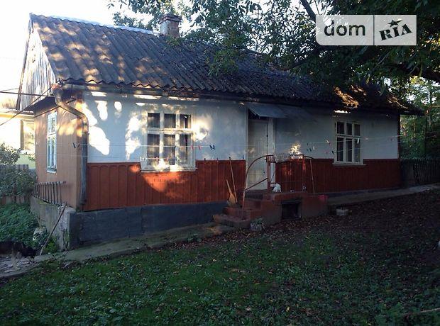одноэтажный дом с садом, 45 кв. м, дерево и кирпич. Продажа в Войнилове (Ивано-Франковская обл.) фото 1
