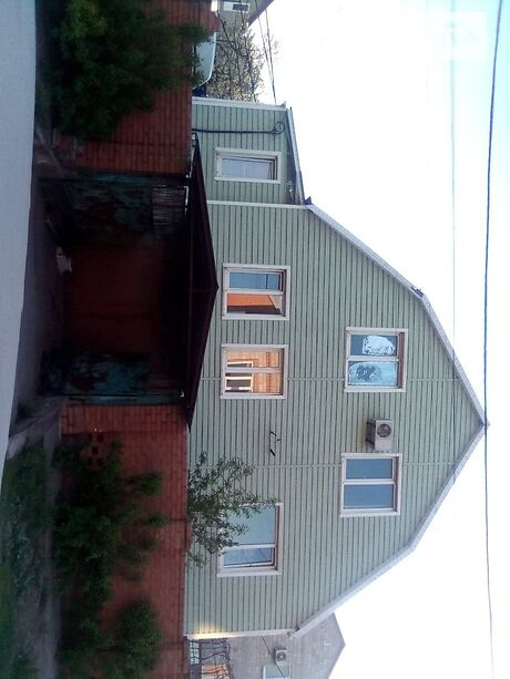 двухэтажный дом с садом, 237 кв. м, монолитно-кирпичный. Продажа в Мариуполе район Центральный фото 1