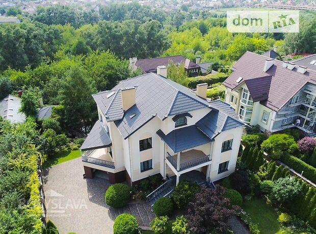 двухэтажный дом с камином, 400 кв. м, кирпич. Продажа в Ровно район Центр фото 1