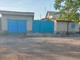 одноэтажный дом с садом, 100 кв. м, дерево и кирпич. Продажа в Украинске (Донецкая обл.) фото 2