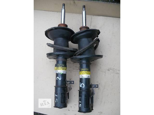 купить бу Б/у амортизатор передний левый 48520-09200 для седана Toyota Avensis 1999г в Николаеве
