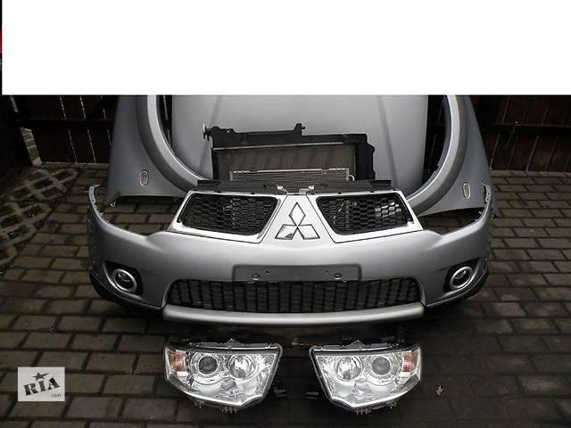 купить бу Б/у бампер передний для легкового авто Mitsubishi Pajero Sport в Здолбунове