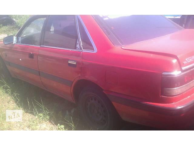 купить бу Б/у четверть автомобиля задняя левая для седана Mazda 626 GD 1988-1991 в Киеве