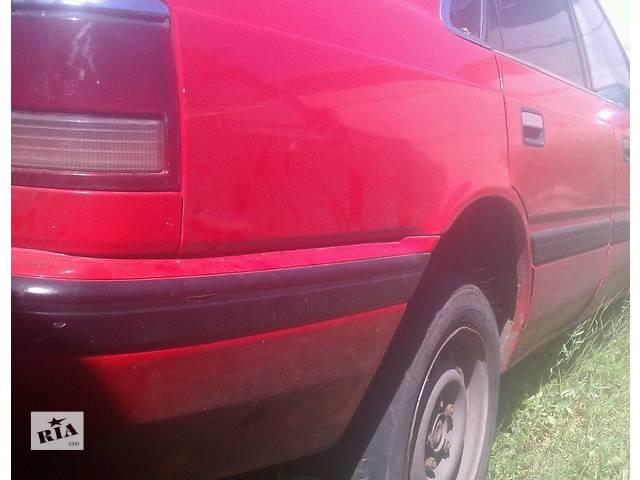 продам Б/у четверть автомобиля для седана Mazda 626 GD 1988-1991г бу в Киеве