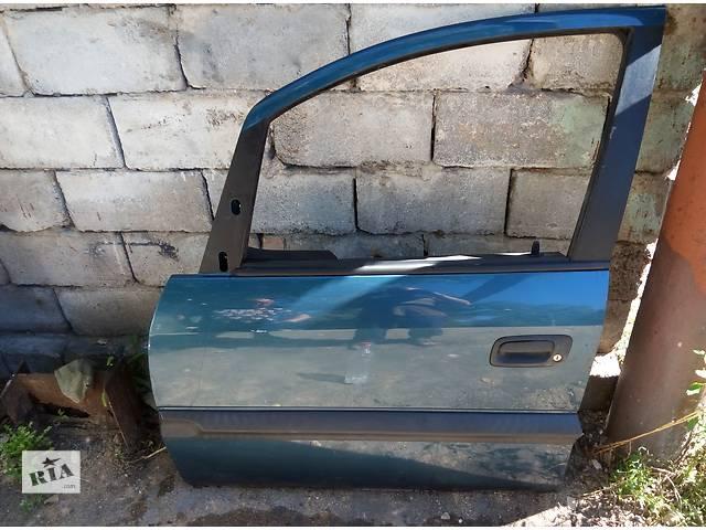 бу Б/у дверь передняя для легкового авто Opel Zafira в Макеевке (Донецкой обл.)