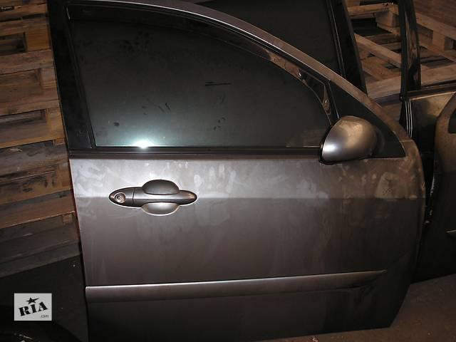 продам Б/у дверь передняя для седана Ford Focus бу в Запорожье