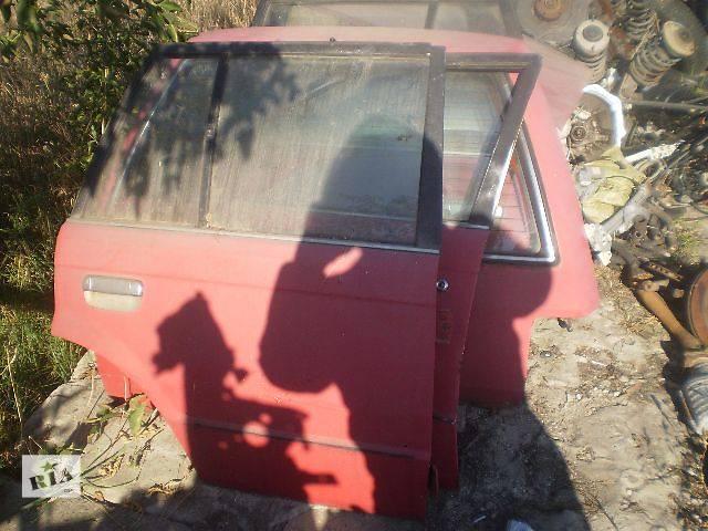 продам Б/у дверь передняя для универсала Mazda 323 1988 бу в Киеве