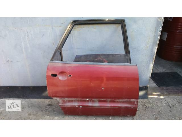 продам Б/у дверь задняя для легкового авто Audi 100 бу в Полтаве