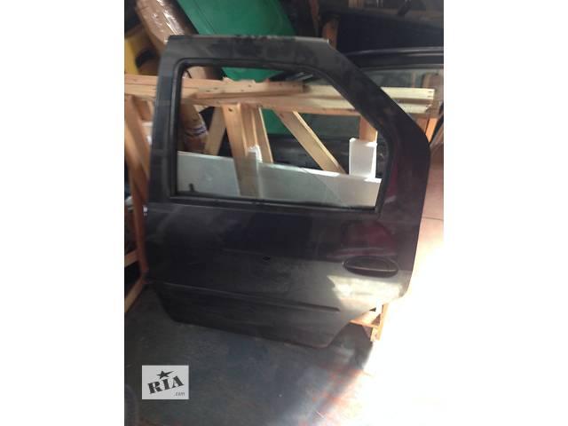 бу Б/у дверь задняя для легкового авто Dacia Logan в Запорожье