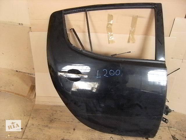 продам Б/у дверь задняя для легкового авто Mitsubishi L 200 бу в Ровно