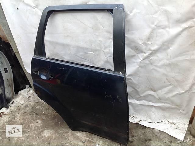 продам Б/у дверь задняя для легкового авто Mitsubishi Outlander XL бу в Киеве