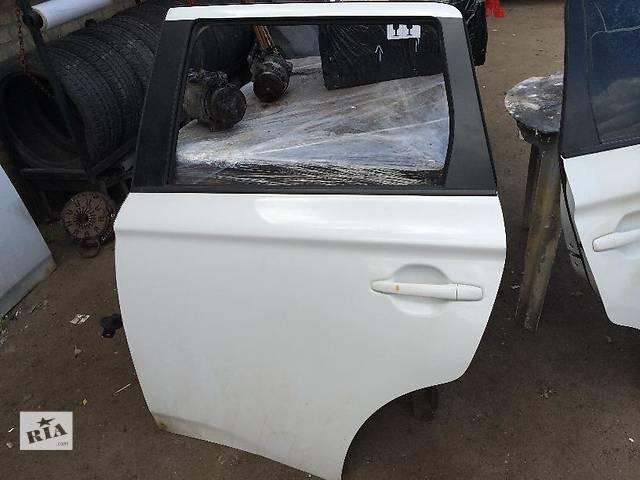 продам Б/у дверь задняя для легкового авто Mitsubishi Outlander бу в Киеве