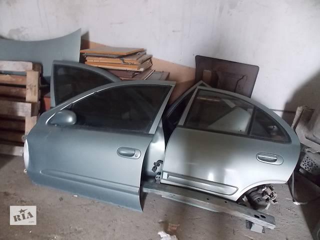 продам Б/у дверь задняя для легкового авто Nissan Almera Classic бу в Львове