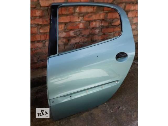 продам Б/у дверь задняя для легкового авто Peugeot 206 Hatchback (5d) бу в Хмельницком