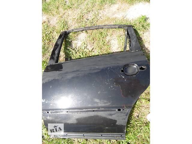 продам Б/у дверь задняя для легкового авто Volkswagen Passat B5 бу в Дубно