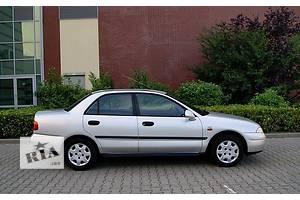 б/у Рычаг Mitsubishi Carisma