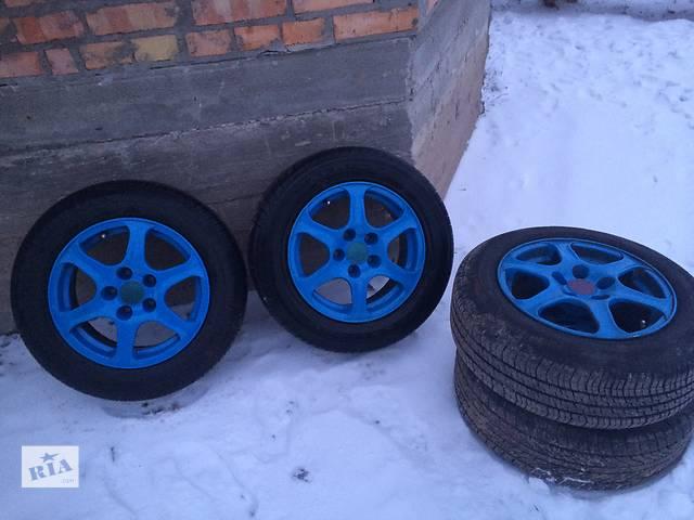 продам Б/у диск с шиной для легкового авто Audi бу в Ровно