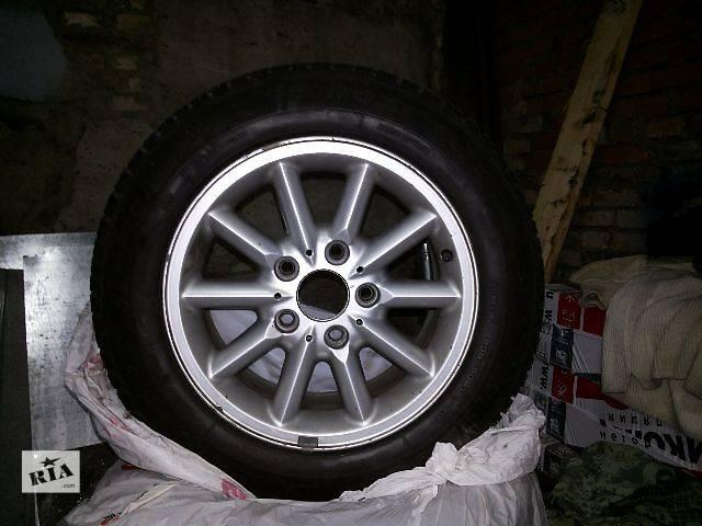 купить бу Б/у диск с шиной для легкового авто BMW R15 5x120 + Резина 205/60 R15 Fulda в Киеве