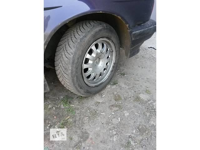 продам Б/у диск с шиной для легкового авто BMW бу в Харькове