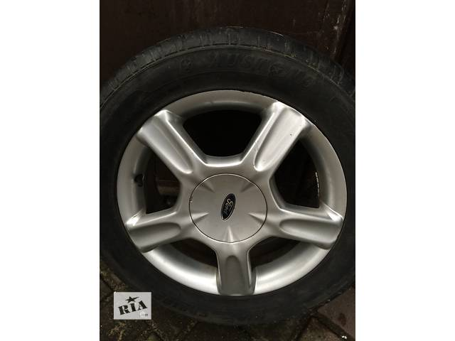 продам Б/у диск с шиной для легкового авто Ford бу в Гайсине