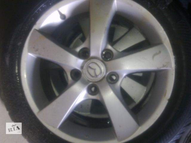 продам Б/у диск с шиной для легкового авто Mazda 3 2005г.  R-16 бу в Луганске