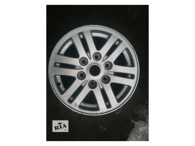 купить бу Б/у диск с шиной для легкового авто Mitsubishi L 200 в Ровно