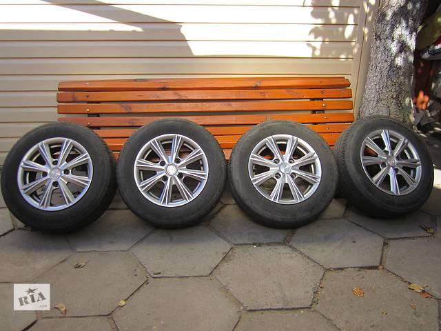 купить бу Б/у диск с шиной для легкового авто Nissan Almera Classic в Житомире