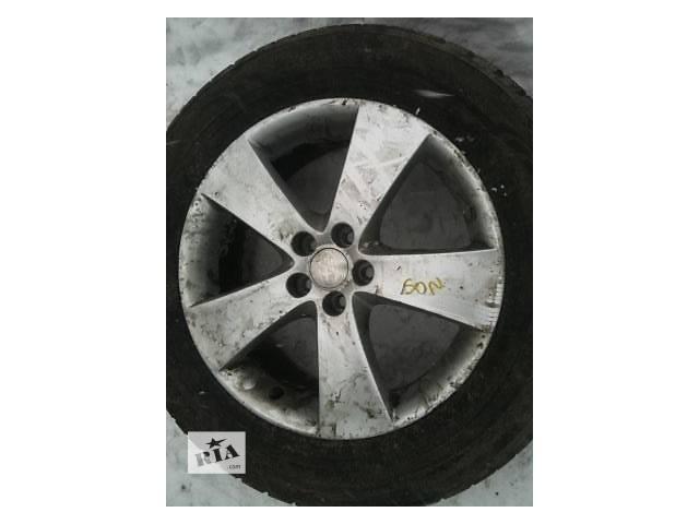 купить бу Б/у диск с шиной для легкового авто Subaru Outback в Ровно