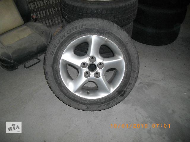 бу Б/у диск с шиной для легкового авто Volkswagen Sharan 1998 в Львове