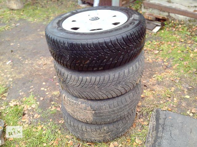 купить бу Б/у диск с шиной для легкового авто Volkswagen Touareg в Сумах