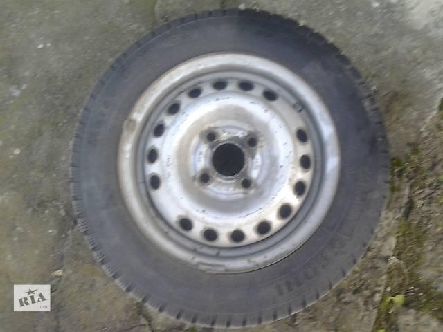 купить бу Б/у диск с шиной для легкового авто в Донецке