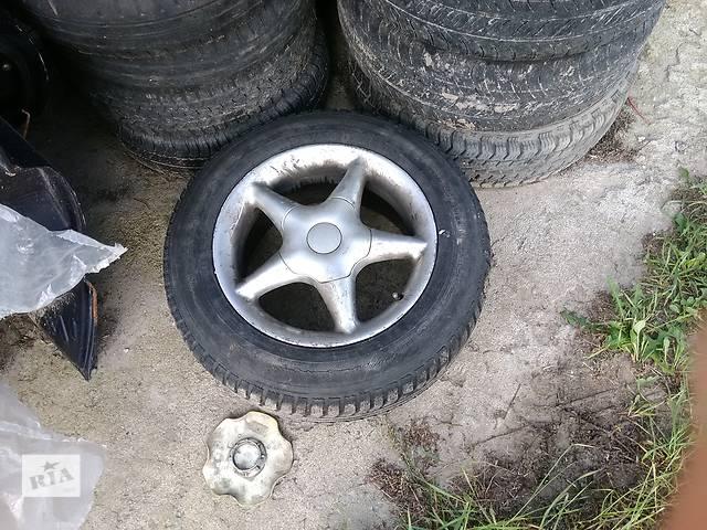 бу Б/у диск с шиной для седана Audi 100 в Киеве