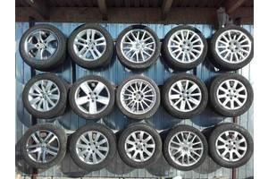 б/в Диск з шиною Volkswagen Golf V