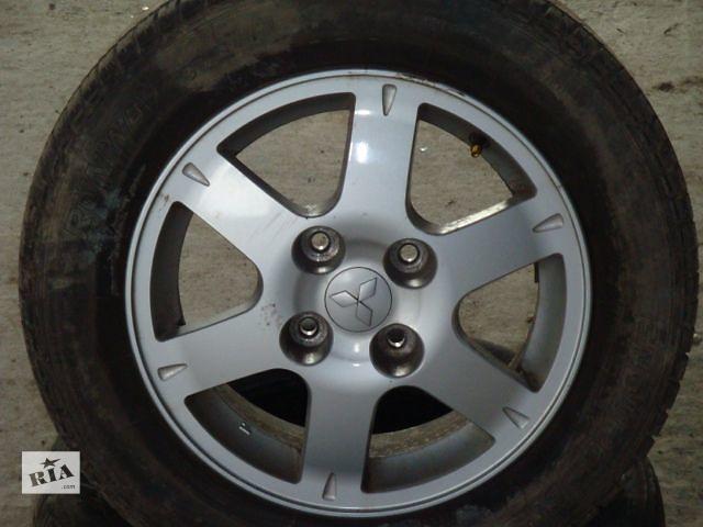 продам Б/у диски 4шт R15 (4 отверствия) Mitsubishi Lancer 2006 бу в Львове