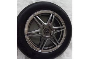 б/у Диск с шиной Mitsubishi Lancer