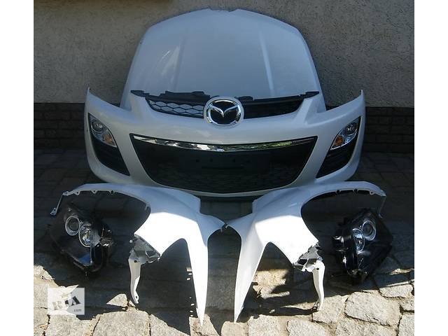 купить бу Б/у Фара левая, правая Mazda CX-7 2010-2012 в Киеве