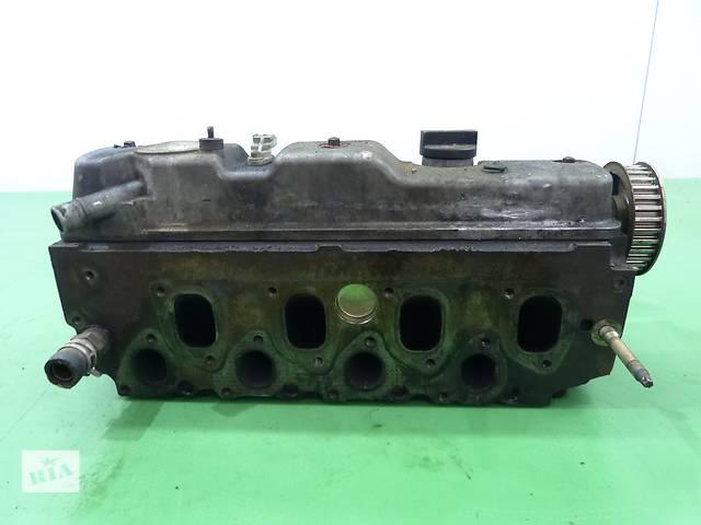 продам Б/у головка блока для легкового авто Ford Focus 1.8 F9DA1D  бу в Яворове