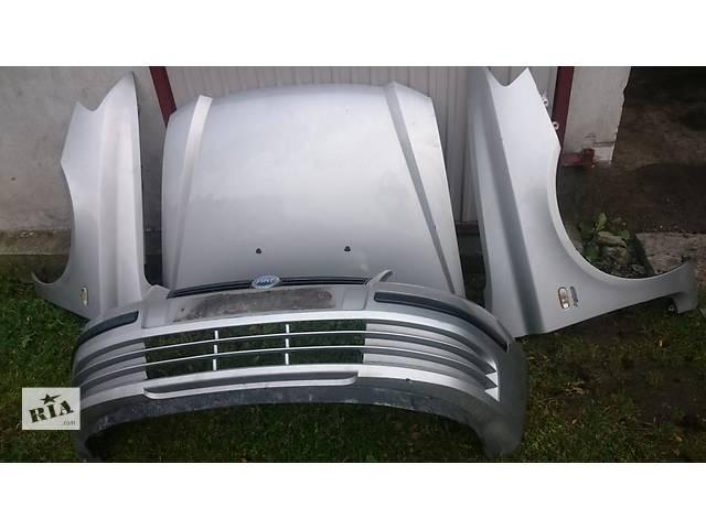 продам Б/у капот для легкового авто Fiat Stilo бу в Львове