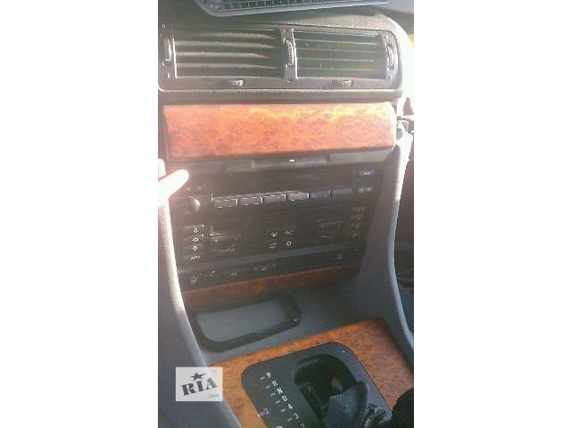 купить бу Б/у панелька под магнитолу для седана BMW 740 Е38 1995 в Киеве
