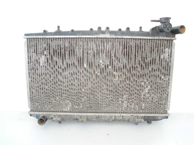купить бу Б/у радиатор для легкового авто Nissan Primera 2.0D P10 (67-34). в Буче (Киевской обл.)