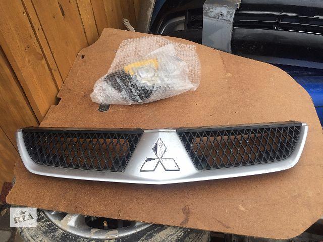 купить бу Б/у решітка бампера для легкового авто Mitsubishi Lancer 9 1,6 в Жовкве