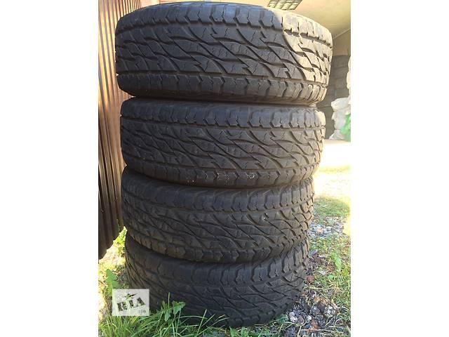 бу Б/у шиныШини Продам комплект резины Bridgestone Dueler 265/65 R17 112T. 697..практически Новый год 2014 пробек 4тис  в Киеве