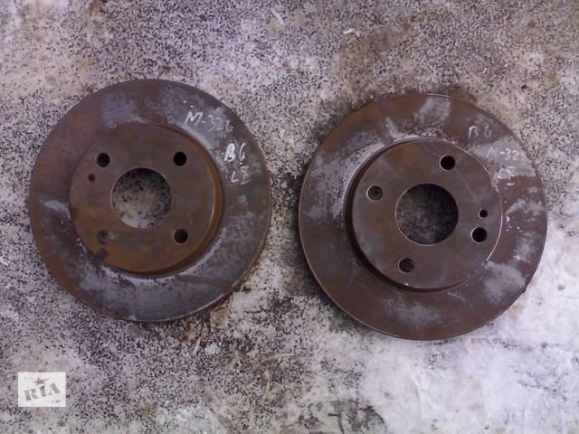 купить бу Б/у тормозной диск для легкового авто Mazda 323 BG (89-94 г) в Сумах
