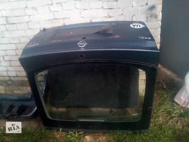 продам Б/у замок кришки багажника для легкового авто Opel Astra бу в Львове